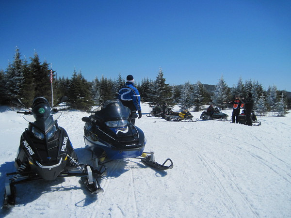 Beautiful March day snowmobiling in Pittsburg NH.