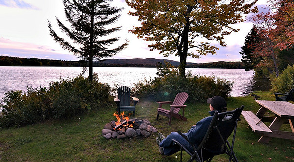 Relaxing by the camp fire at Tall Timber Lodge.
